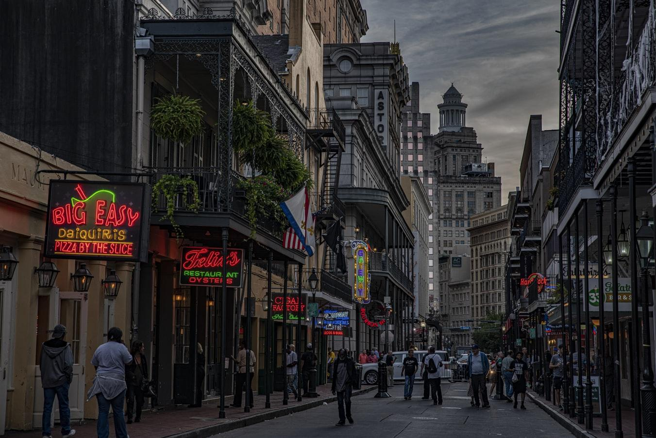 A view of a busy street in New Orleans at night.